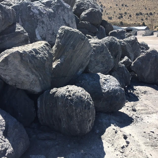 3 to 4 foot charcoal boulders.